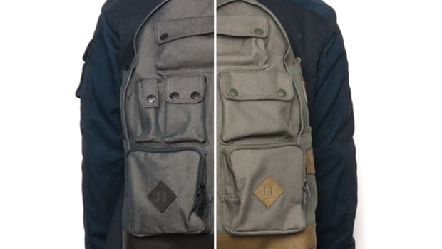 white-mountaineering-porter-ox-multi-pocket-daypack-00