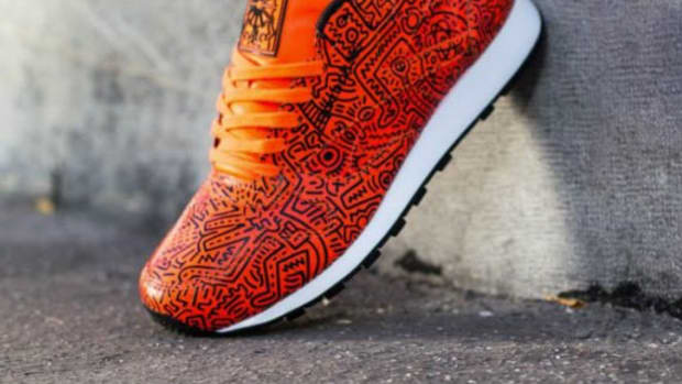 53816e21227 Keith Haring x Reebok Classic Leather Lux - Orange All-Over Print