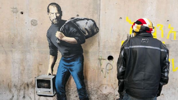 banksy-shows-steve-jobs-as-a-syrian-migrant-1