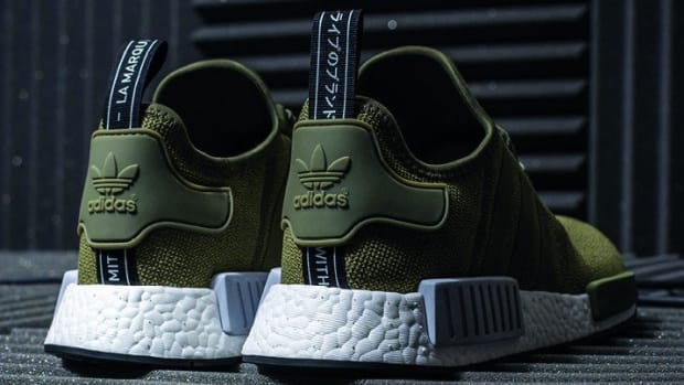 76894ac51daf6 This New adidas NMD R1 Contrasts a Midnight Grey Upper With a Glow ...