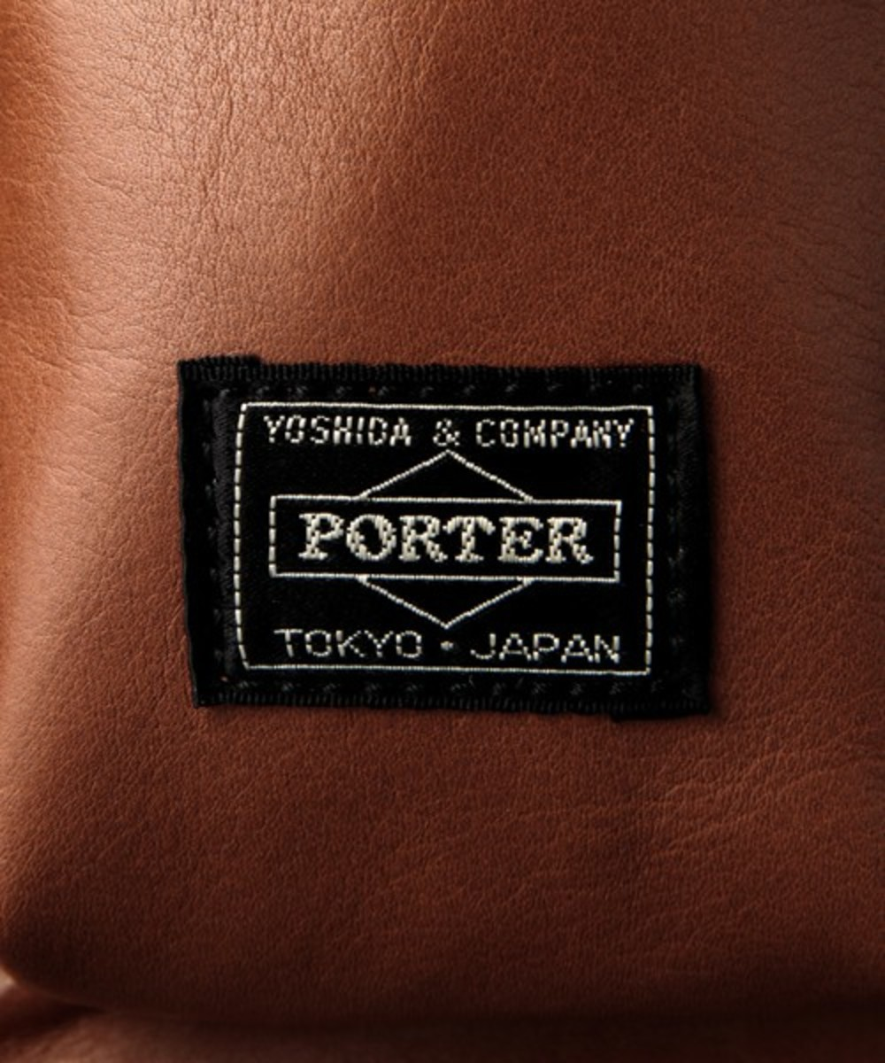 white-mountaineering-porter-yoshida-leather-waist-bag-11