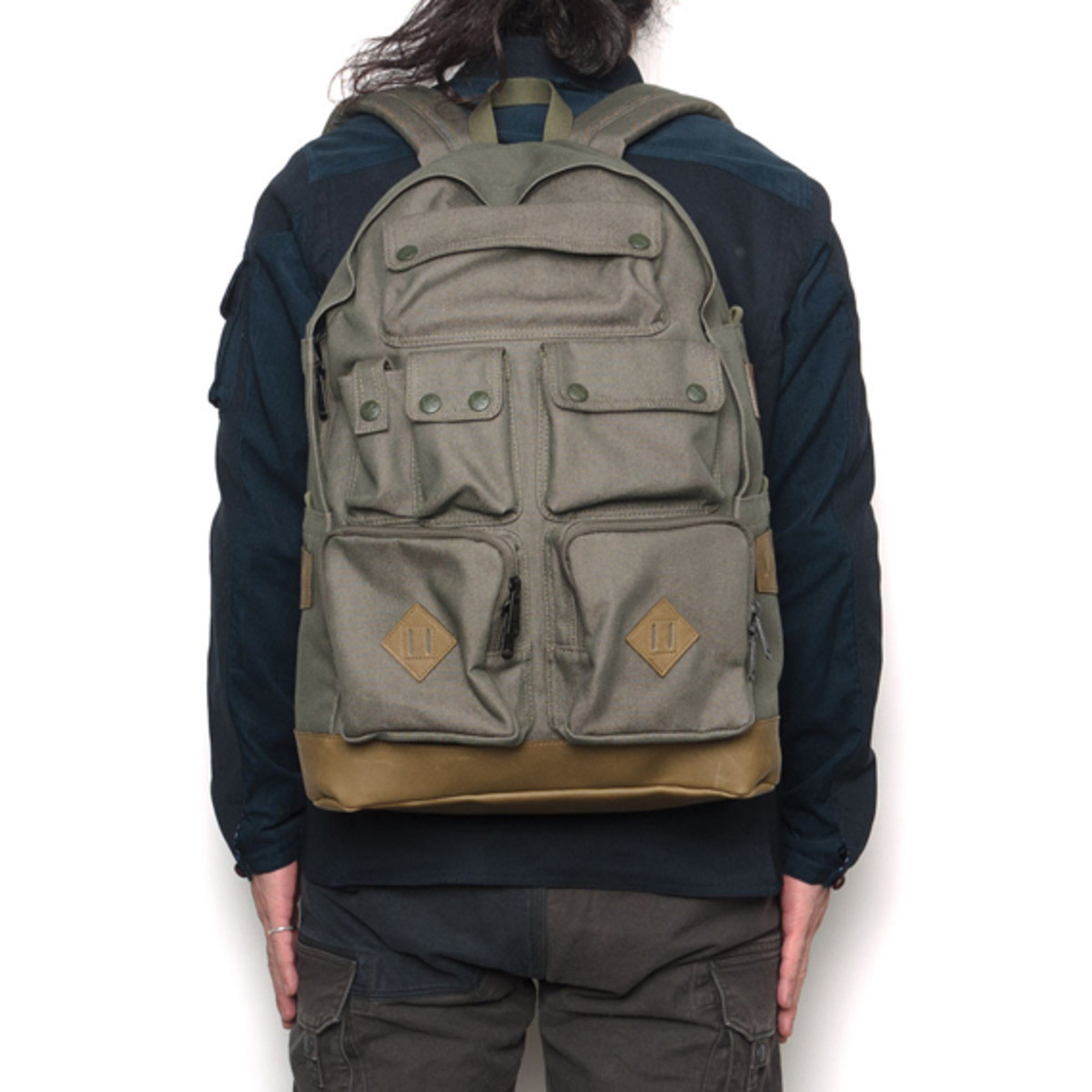 white-mountaineering-porter-ox-multi-pocket-daypack-06