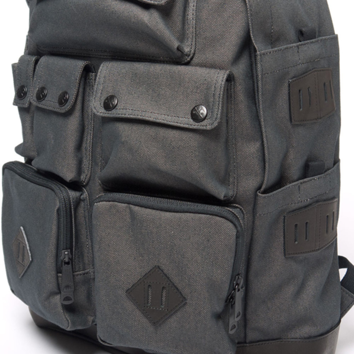 white-mountaineering-porter-ox-multi-pocket-daypack-05