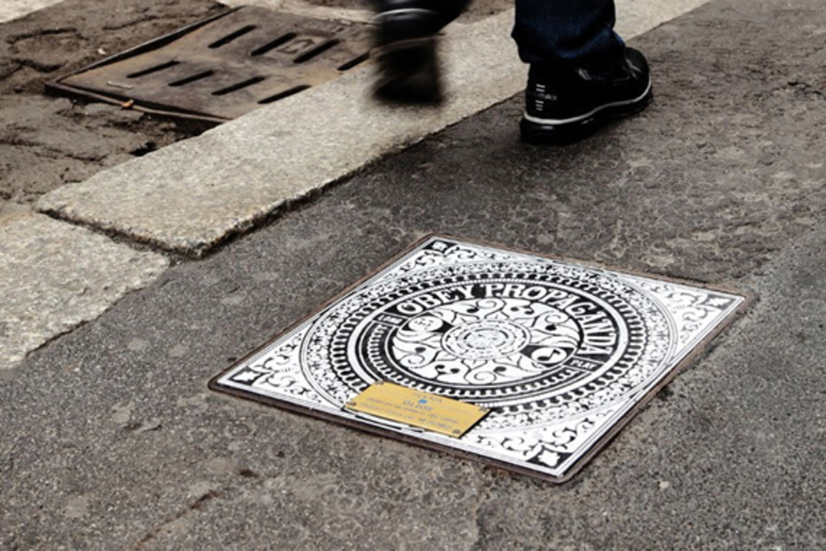 over-the-under-manhole-cover-art-1