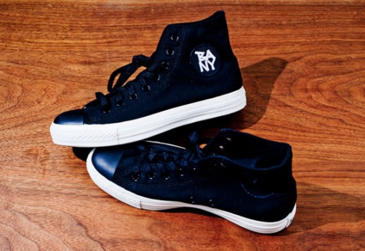 3. Black Apple Converse Chuck Taylors