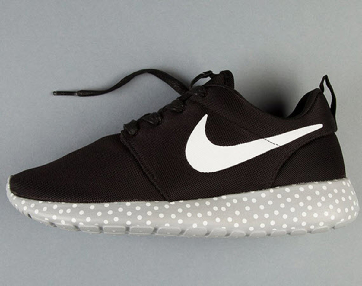 new arrival e59e2 c36da Jazzing up an otherwise classic look from the Swoosh, Nike outfits the  versatile and comfortable Roshe Run with a fun polka dot ...
