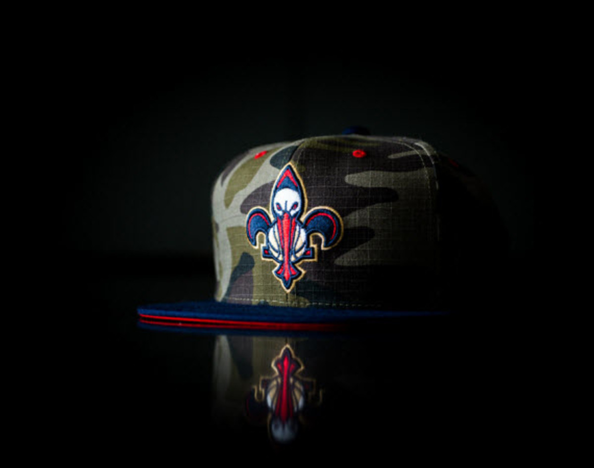8ecaa6ff589e6 Sneaker Politics shows their hometown love with a new batch of New Orleans  Pelicans snapbacks produced in collaboration with sportswear label Mitchell  ...