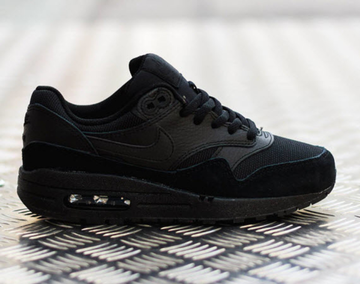 Nike continues with its Triple Black theme with the latest model to don the  hot summer look being the Nike Air Max 1 GS. Several models over the summer  have ... 22680c6bfc8