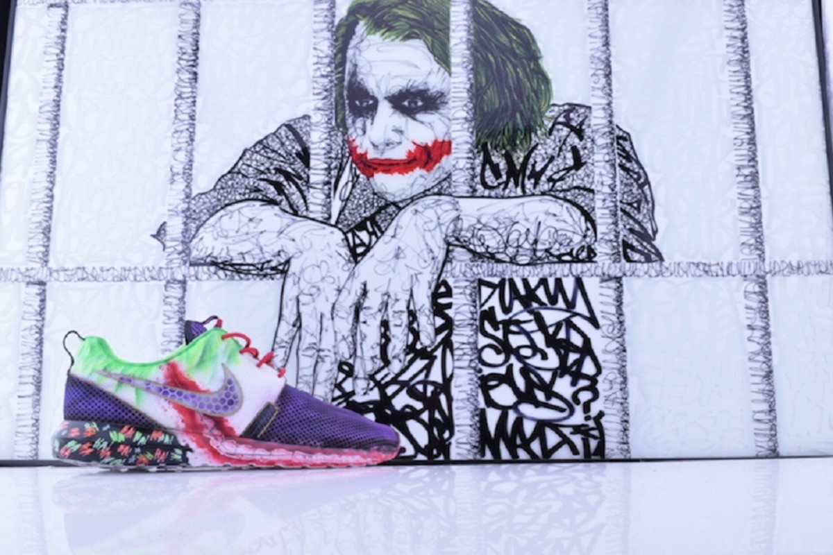 differently c8954 8a466 Featuring a prominent recreation of the equally creepy and mischievous Joker  smile and his white, purple, ...