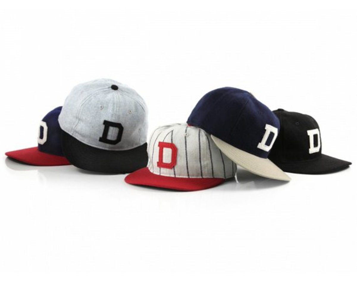 DQM has gotten together with throwback cap and jersey specialists Ebbets  Field Flannels on a collection of five custom made wool flannel baseball  caps. 0ebbd2aaec1
