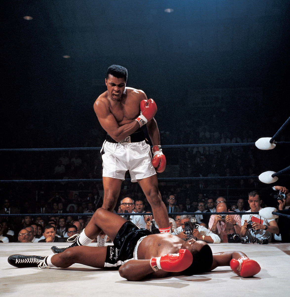 Muhammad Ali after first round knockout of Sonny Liston during World Heavyweight Title fight at St. Dominic's Arena in Lewiston, Maine on 5/25/1965. Photo by Neil Leifer—Sports Illustrated