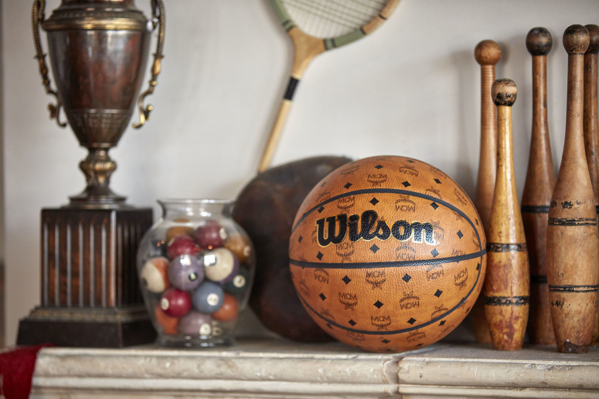 mcm teams up with wilson sporting goods on a limited-edition football and basketball