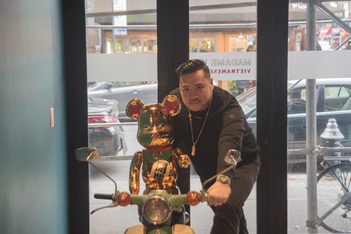Chef Jimmy Ly with a gold Money Cat BE@RBRICK and scooter